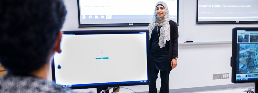 a student making a presentation at the front of a classroom