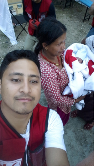 photo of Sushan Pradhan, Disaster and Emergency Management alumni with earthquake survivors in the background